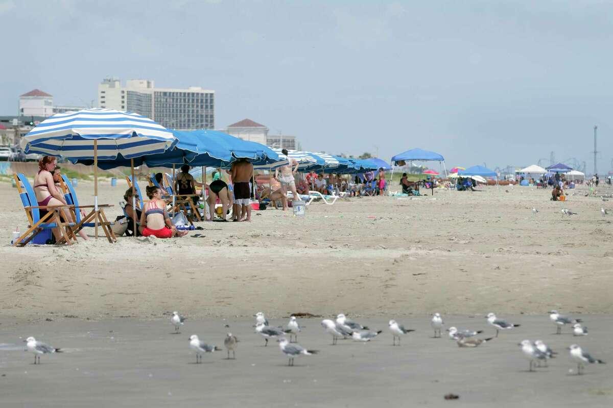 As hurricane Ida reaches Louisiana, beach goers take advantage of calmer conditions near 75th Street and Seawall Boulevard Sunday, Aug. 29, 2021 in Galveston, TX.
