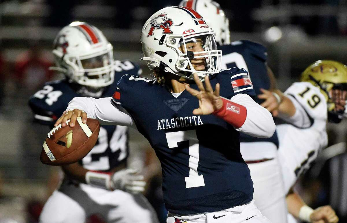 Atascocita quarterback Gavin Session throws a pass during the first half of a high school football game against Klein Collins, Thursday, Aug. 26, 2021, in Humble.