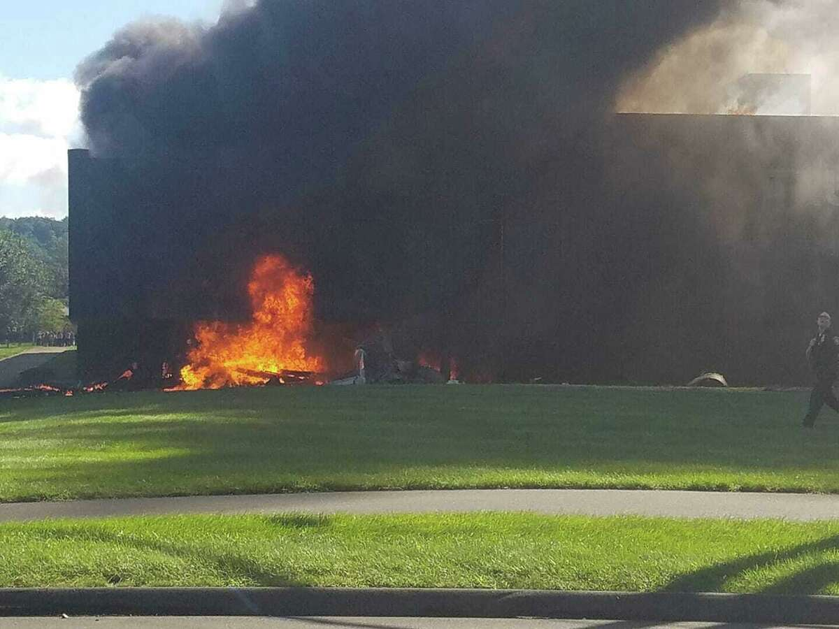 A small jet crashed into the Trumpf Inc. building on Hyde Road in Farmington on Thursday killing four people aboard, authorities said. The plane and building were quickly engulfed in flames, officials said.