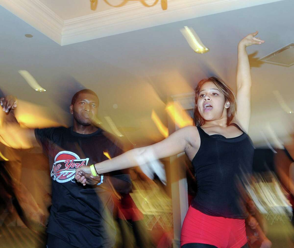 Salsa dancers, Eddie Ballesteros, left, and Diana Hoyos, members of a dance team from Elizabeth, N.J., perform during the 11th annual Connecticut Salsa Dancing Fest at the Marriott Hotel & Spa in Stamford in 2015. After a year's hiatus and a new name, the Tri-State Dance Festival is returning to Stamford this weekend.