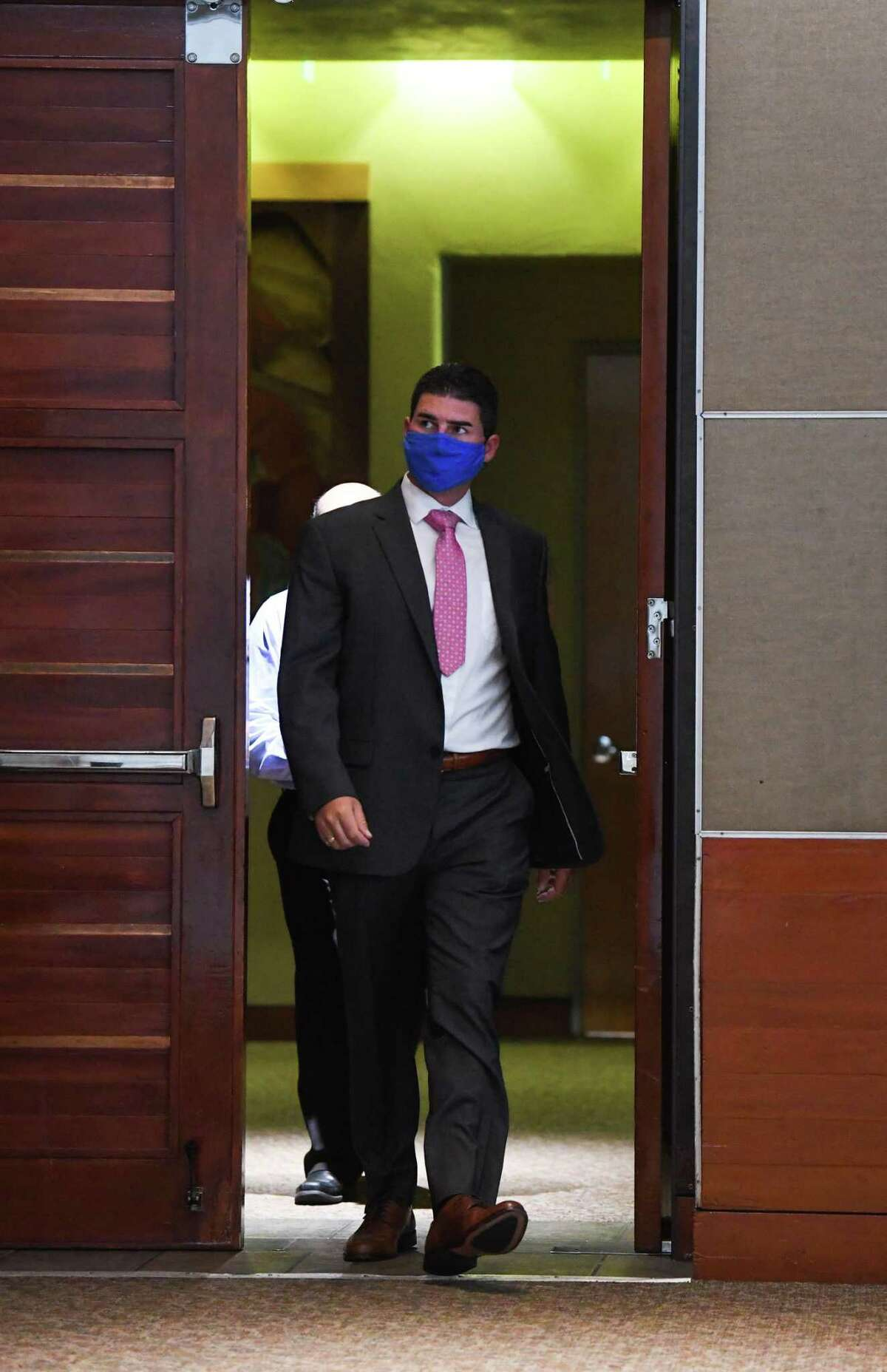 Fired San Antonio Police Detective Daniel Pue, who is accused of repeatedly punching a woman, arrives for his arbitration hearing on Thursday, Sept. 2, 2021.