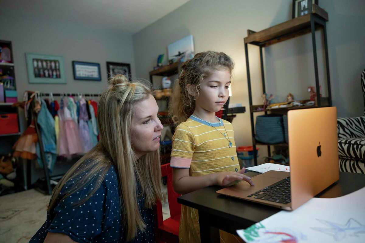 Summer Hull, left and her 6-year-old daughter, participate in virtual learning in their home, Thursday, Sept. 2, 2021, in Conroe. CISD is offering a limited virtual option this semester for student between pre-kindergarten and sixth grade who qualified though the district doesn't plan on offering it next semester.