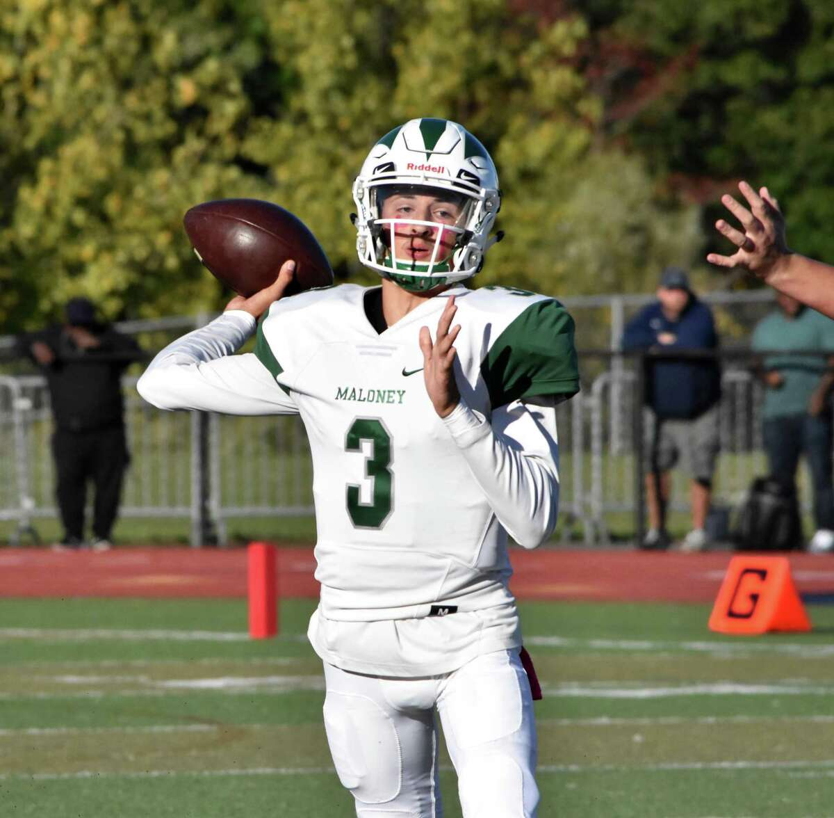 Maloney's Angel Arce throws a pass against Middletown at Middletown high on Oct. 4, 2019.