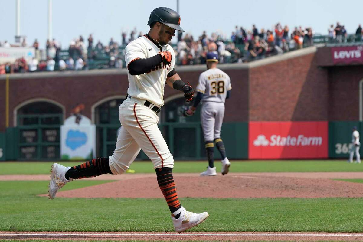 San Francisco Giants' Thairo Estrada runs the bases after hitting a three-run home run off of Milwaukee Brewers pitcher Devin Williams (38) during the eighth inning of a baseball game in San Francisco, Thursday, Sept. 2, 2021. (AP Photo/Jeff Chiu)
