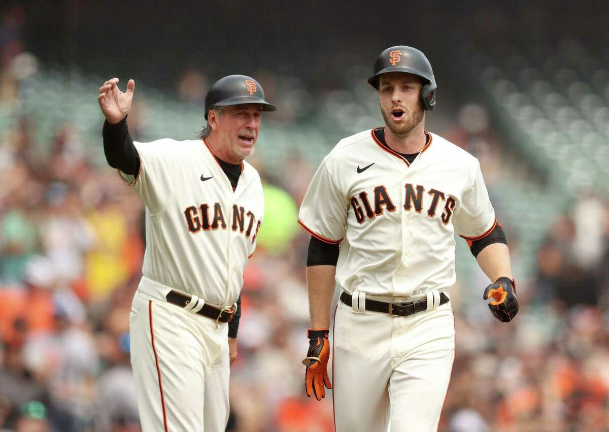 SAN FRANCISCO, CALIFORNIA - SEPTEMBER 02: Austin Slater #13 of the San Francisco Giants is congratulated by third base coach Ron Wotus after he hit a lead off home run in the first inning against the Milwaukee Brewers at Oracle Park on September 02, 2021 in San Francisco, California. (Photo by Ezra Shaw/Getty Images)
