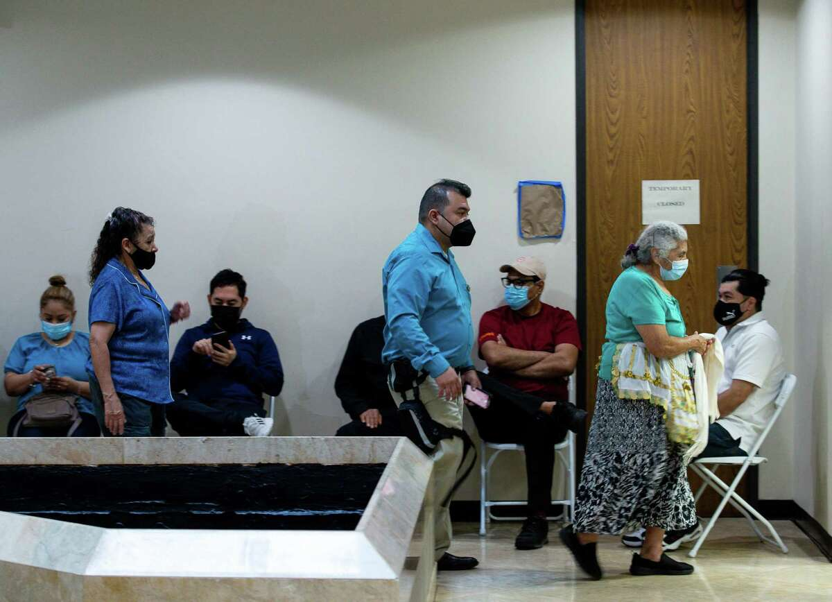 People wait to get the COVID-19 Moderna vaccine at the Consulado General de El Salvador on Thursday, May 6, 2021, in Houston.