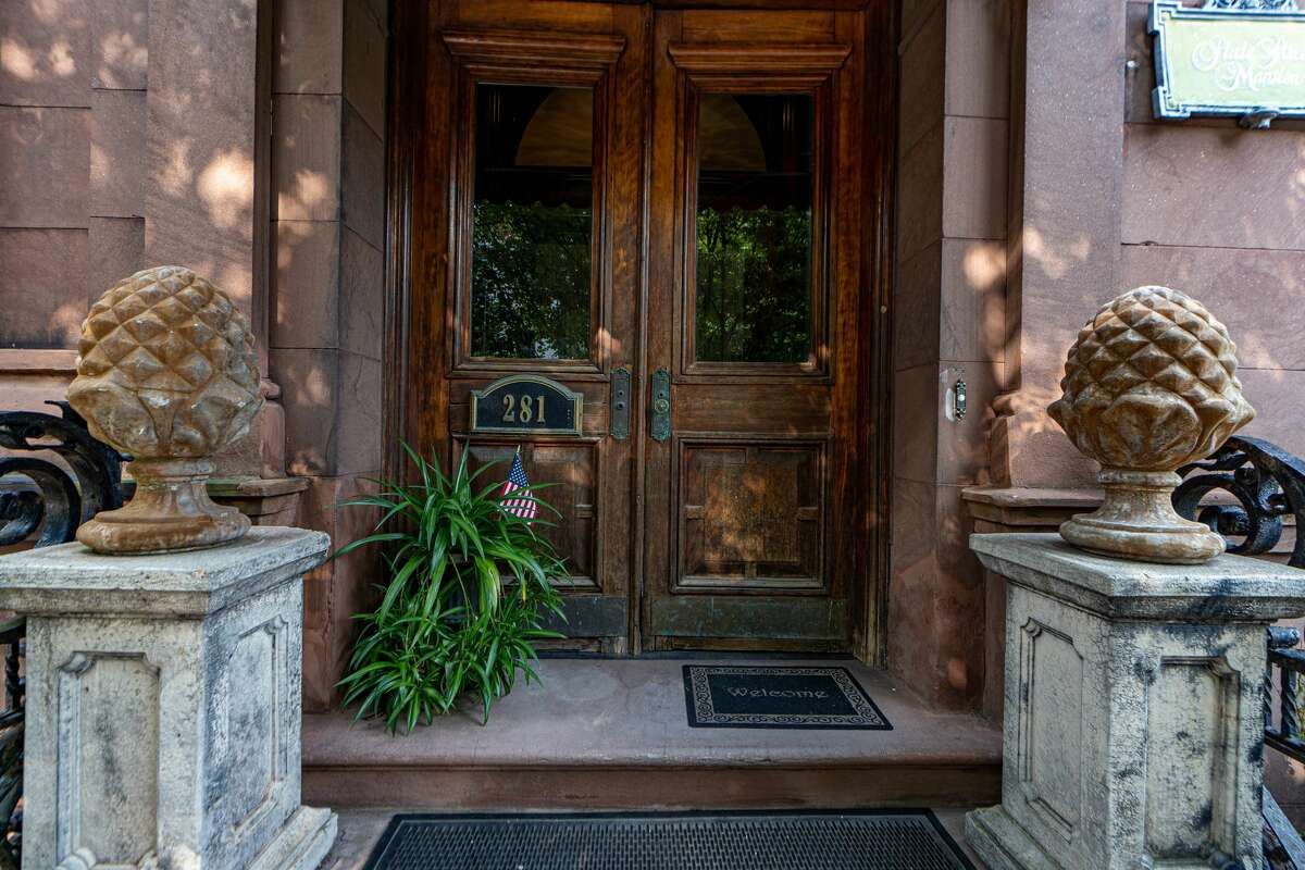 This week's house is a brownstone mansion at 281 State St. in Albany's Center Square, built in 1880 as a single-family home and currently used as a bed-and-breakfast. It is 8,487 square feet and has 10 rooms set up as bedrooms. The current owner was restoring the property, but has decided to sell it instead and recently dropped the price by $100,000. The bedrooms could be converted to apartments. Highlights include flamboyant wrought iron railings installed in 1896; a gorgeous carved staircase, inlaid wood floors and impressive mouldings, chandeliers and marble staircases throughout the building. Parking for 10-plus vehicles in the back. Taxes: $21,352. List price: $699,000. Contact listing agent Colin McDonald with McDonald Real Estate Company at 518-505-4977.