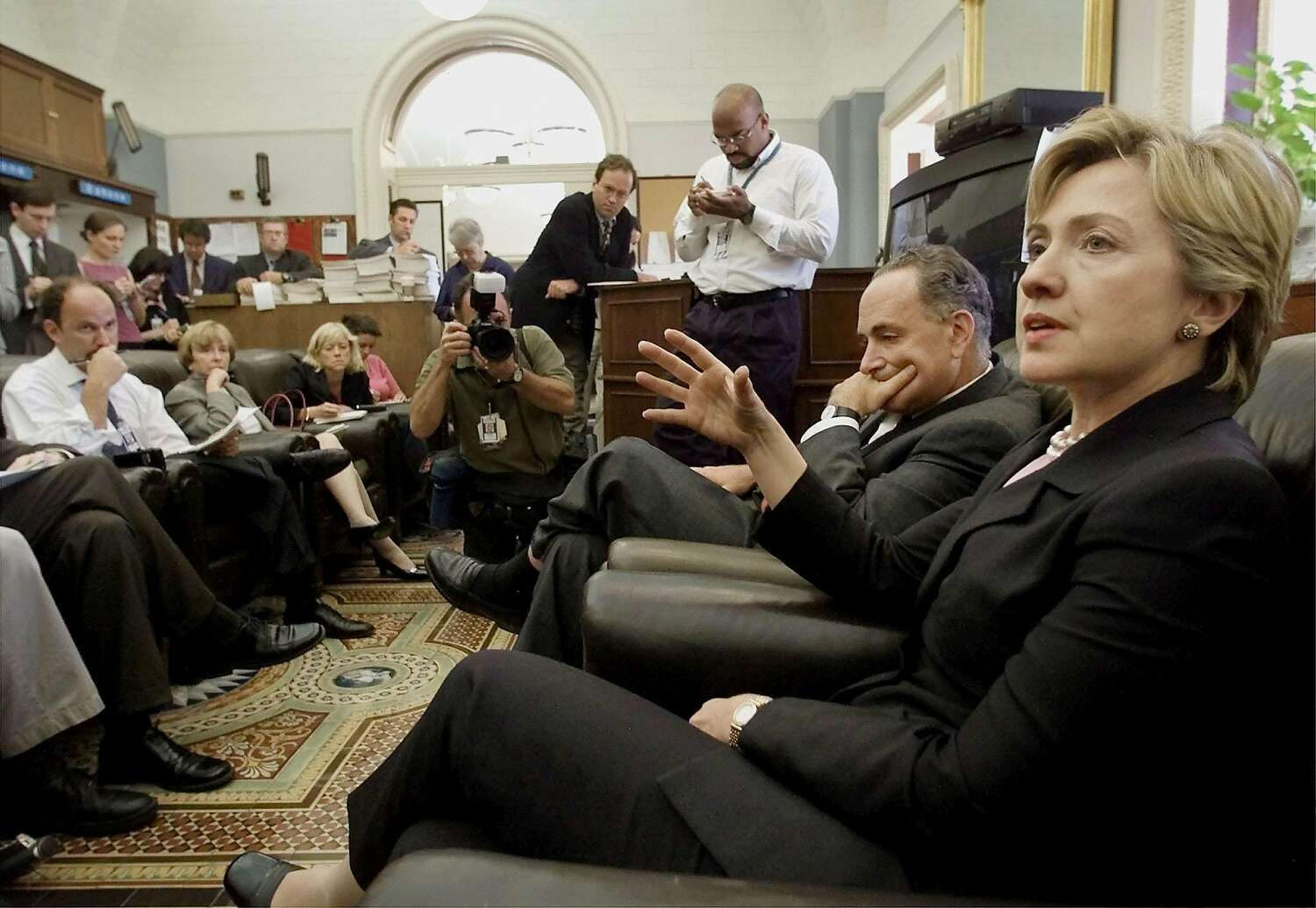 Sen. Hillary Clinton and Charles Schumer speak with members of the press at the U.S. Capitol on Sept. 12, 2001.