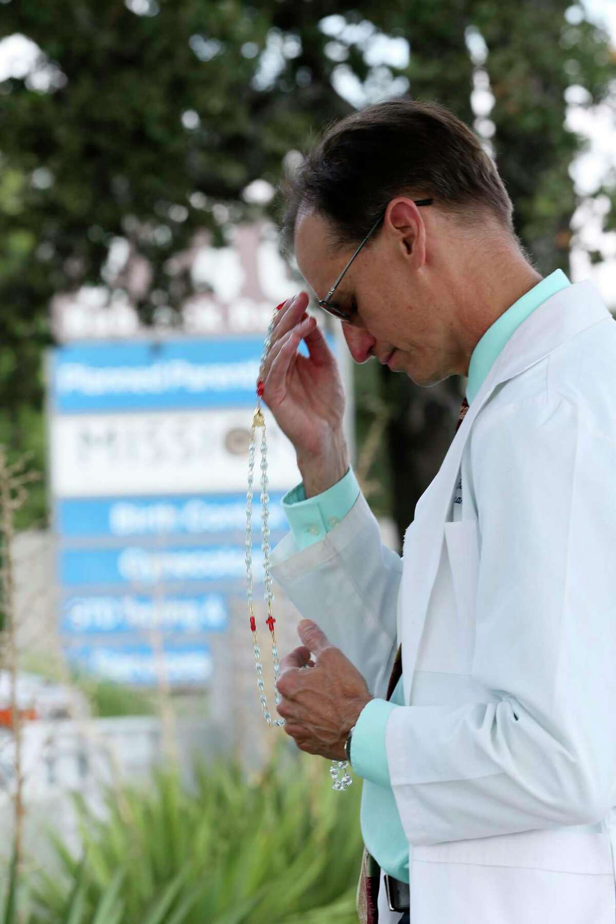 Family practitioner Dr. Mitch Finnie, 56, recites the Rosary in front of the Planned Parenthood offices on Babcock Road, Thursday, Sept. 2, 2021. Finnie said he does it once a week.