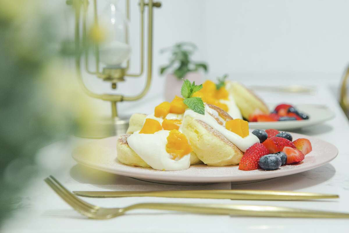 Fluffy Japanese souffle pancakes, here topped with cream and mango, are the focus of Sunnyvale's Hanabusa Cafe.