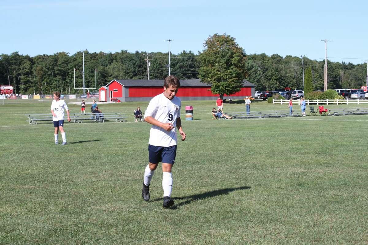 Manistee senior Evan Dalke runs through practice drills minutes before kickoff on Thursday afternoon.