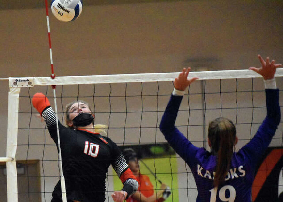 Edwardsville's Emma Garner goes up for one of her six kills during the second game against the Collinsville Kahoks.