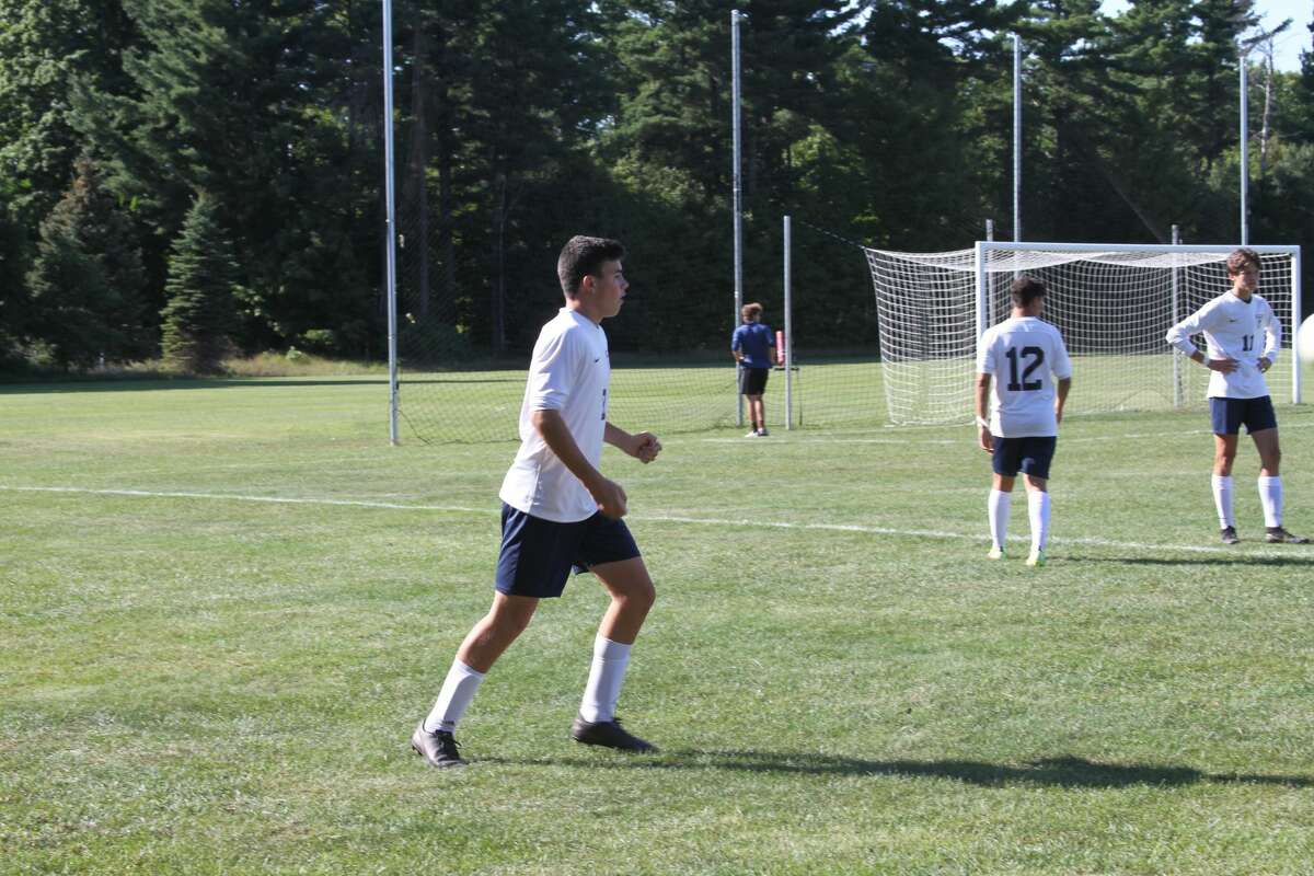 Manistee sophomore Jacob Sharp warms up before facing Benzie Central on Thursday afternoon.