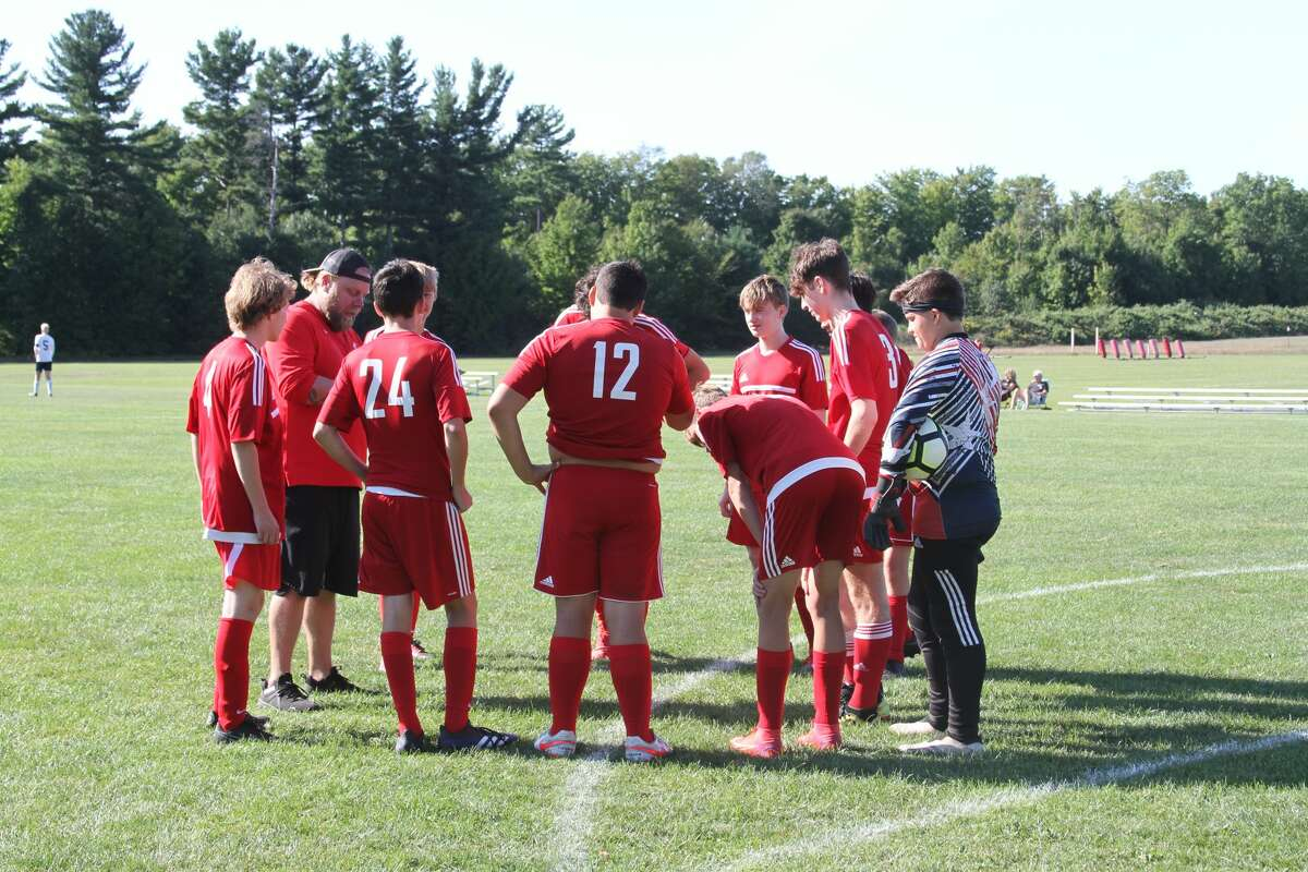 Benzie Central soccer huddles up before kickoff on Thursday afternoon.