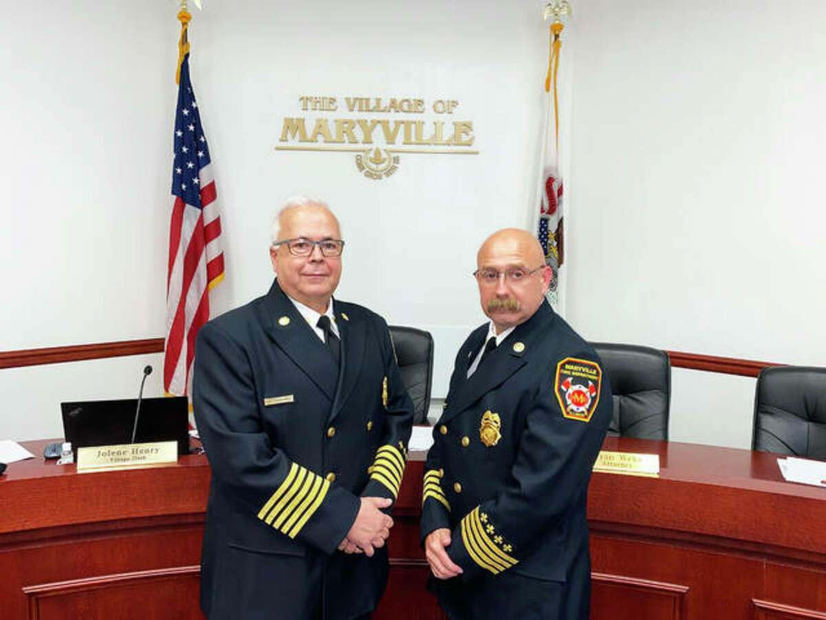 Maryville Fire Chief Kevin Flaugher, left, retired after 37 years of service while George May, former deputy fire chief, was promoted to fire chief.