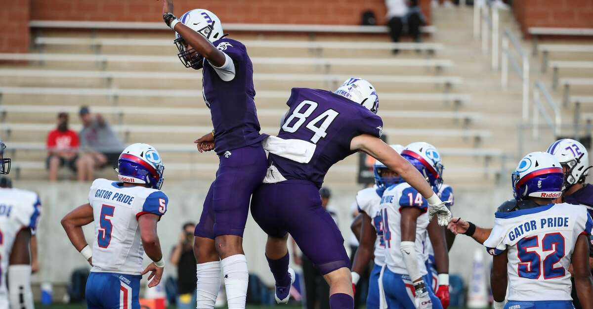 Ridge Point quarterback Bert Emanuel, Jr., (3) celebrates his 9-yard touchdown run against Dickinson with tight end Carter Groen (84) during the first half of a non-district high school football game at Freedom Field Thursday, Sept. 2, 2021 in Rosharon.