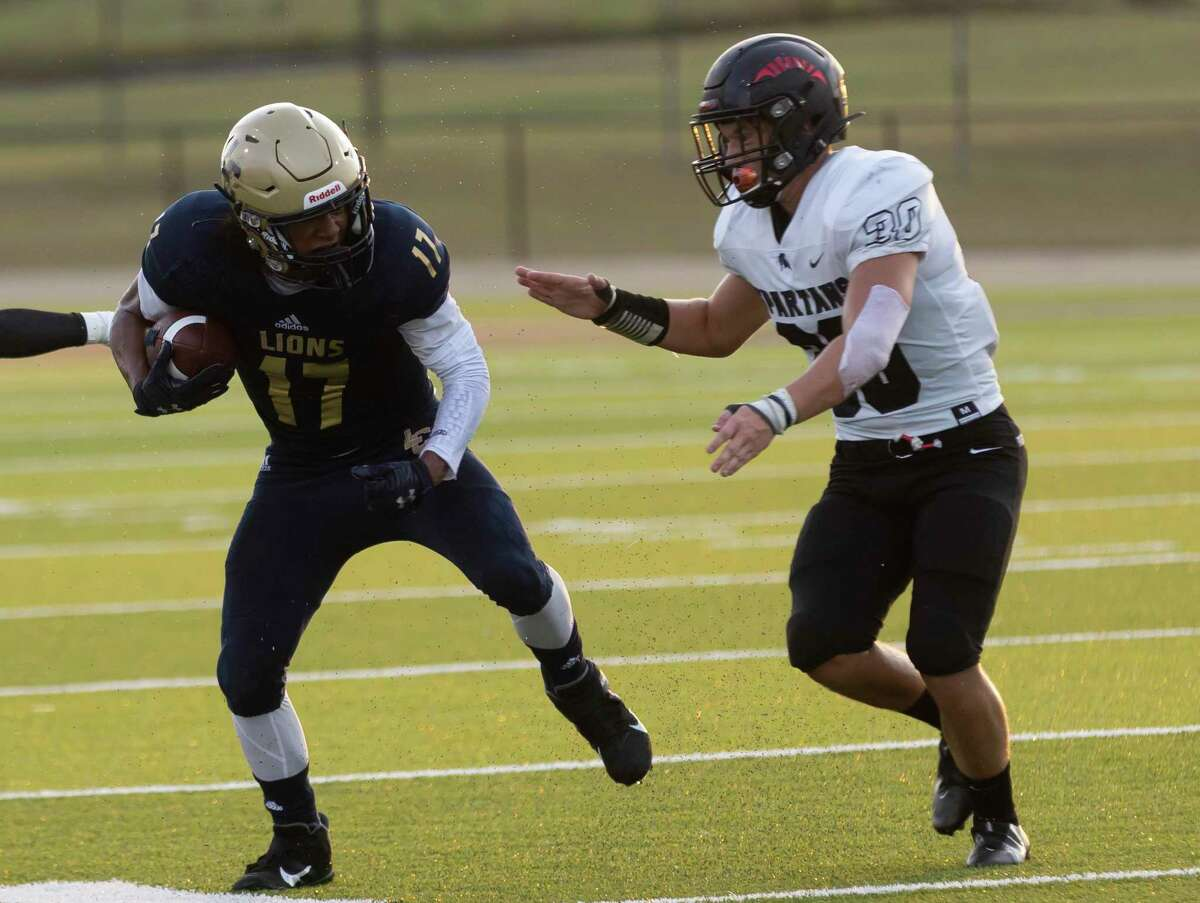 Lake Creek running back Justin Freeney (17) looks to maneuver through Porter safety Sean Ingram (30) during the first quarter of a non-district football game at MISD Stadium on Thursday, Sept. 2, 2021, in Montgomery.