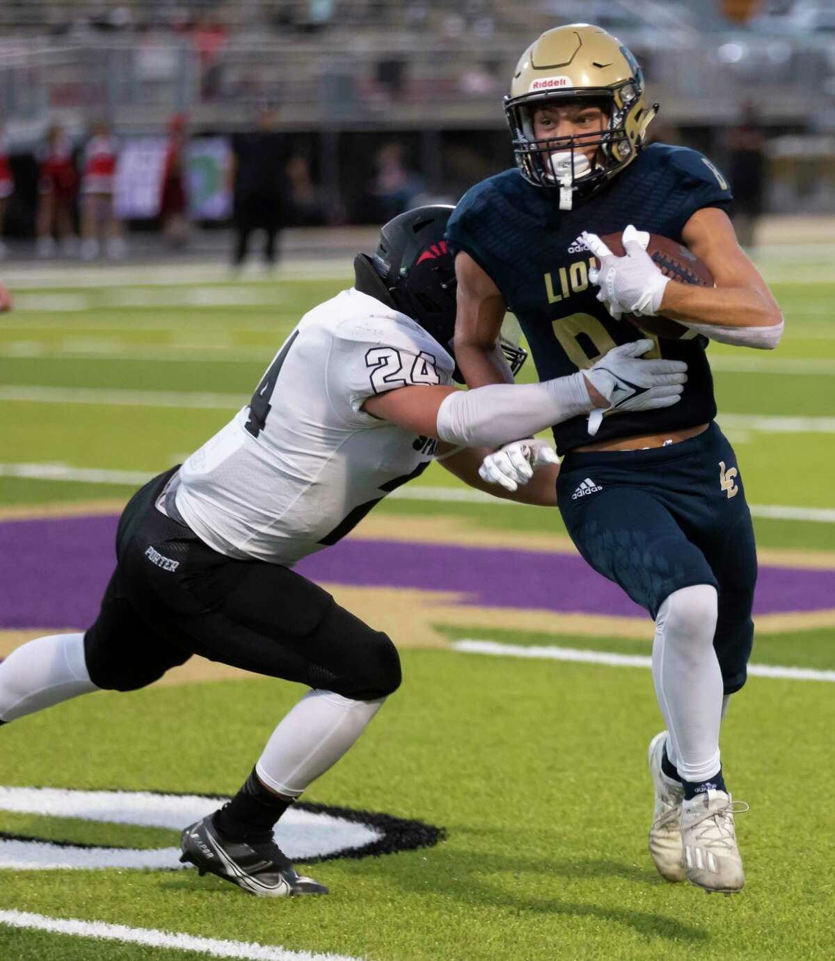 Lake Creek wide receiver Kolbey Wisnieske (87) is tackled by Porter linebacker David Walls (24) during the second quarter of a non-district football game at MISD Stadium on Thursday, Sept. 2, 2021, in Montgomery.