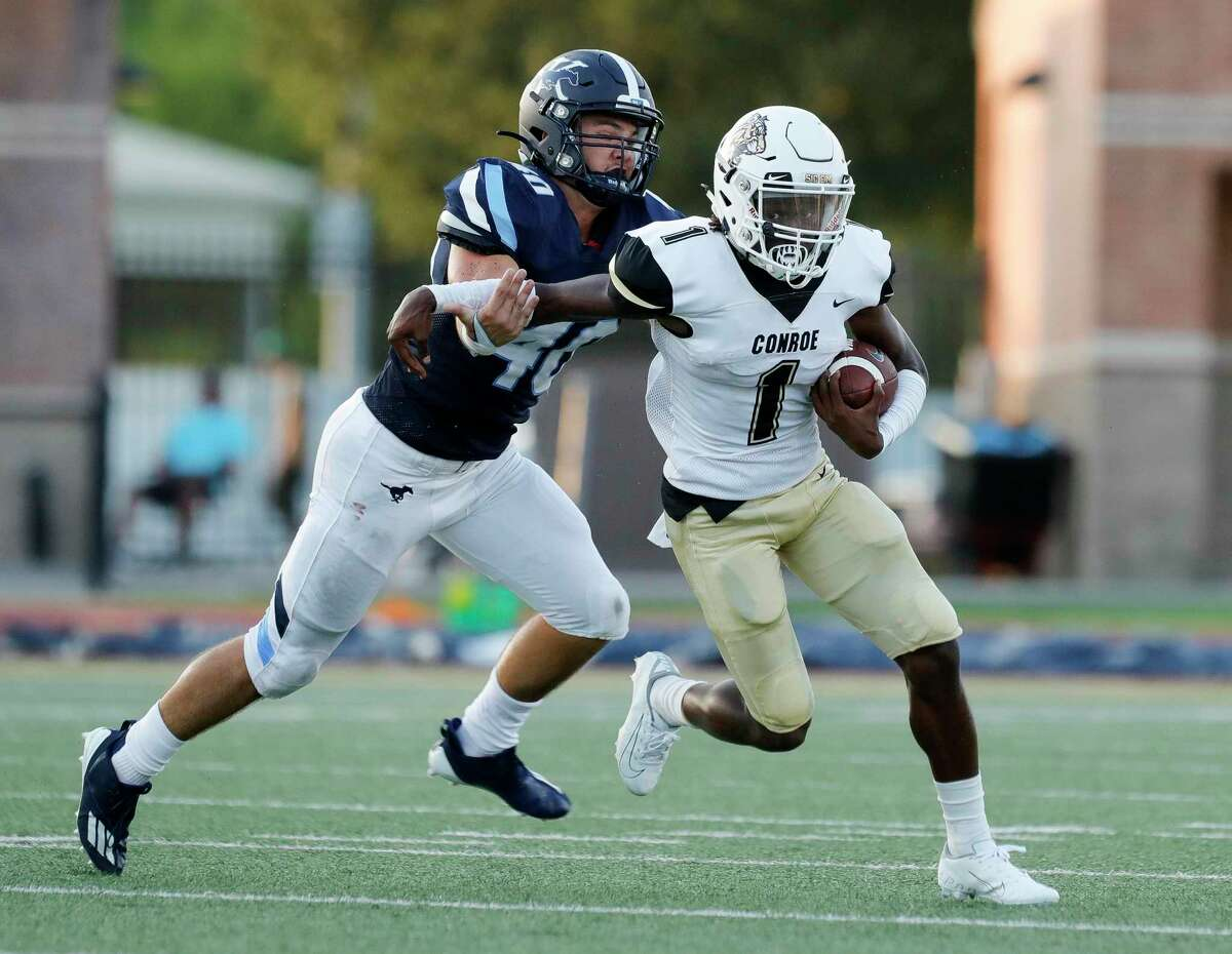Conroe running back Thomas Jackson (1) gets past Kingwood middle linebacker Grant Mize (40) during the first quarter of a non-district high school football game at Turner Stadium, Thursday, Sept. 2, 2021, in Humble.