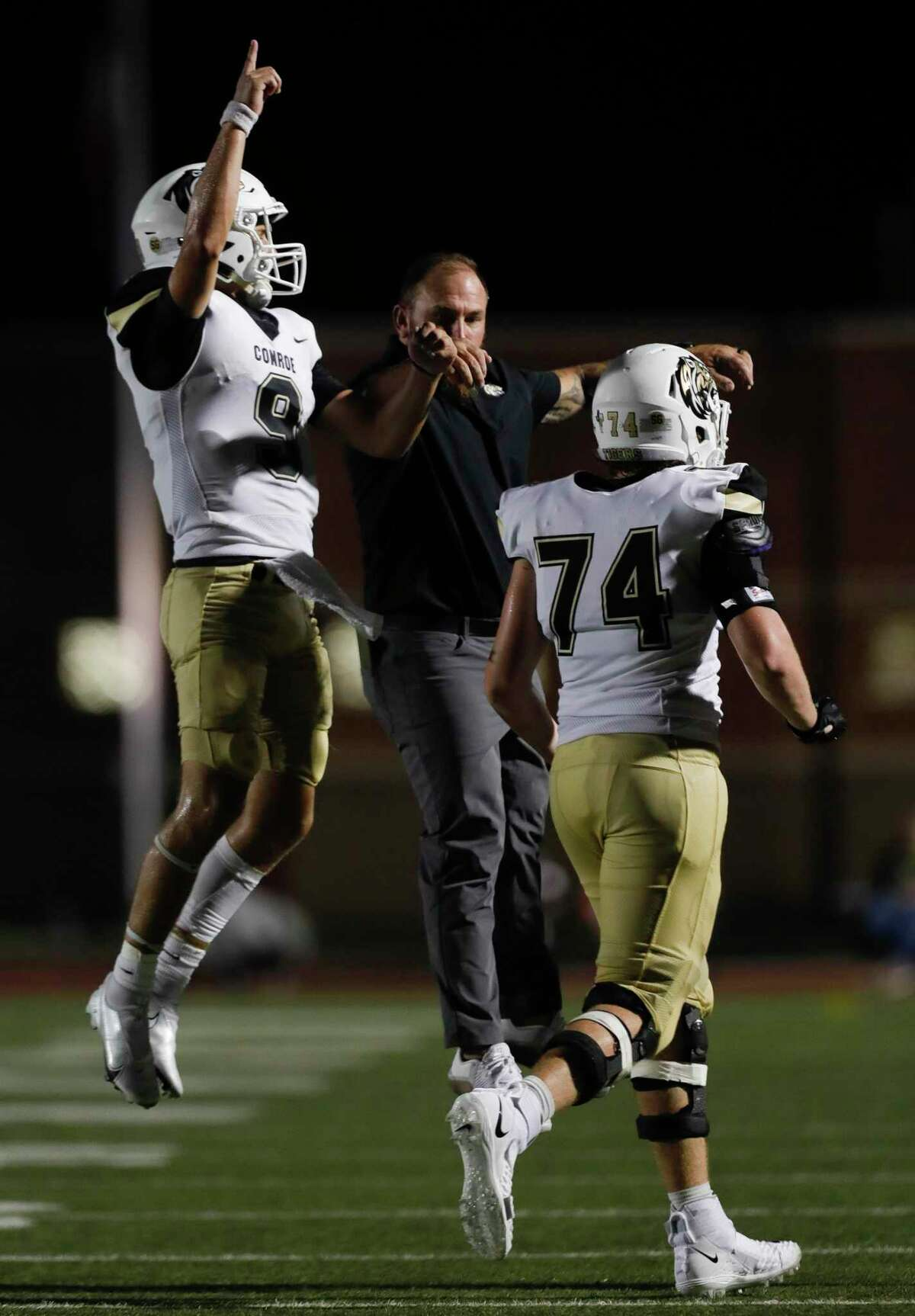 Conroe starting quarterback Clayton Garlock (9) reacts after a touchdown during the third quarter of a non-district high school football game at Turner Stadium, Thursday, Sept. 2, 2021, in Humble.