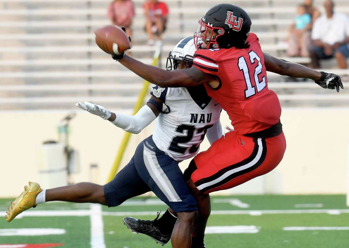 Lamar's Marcellus Johnson reaches to complete the pass against pressure from North American during their season opening home game Thursday. Photo made Thursday, September 2, 2021 Kim Brent/The Enterprise