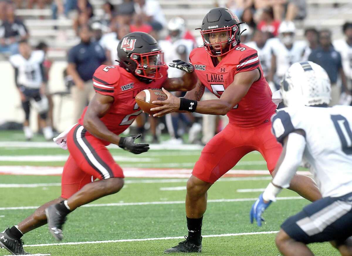 Lamar's Jalen Dummett hands off the ball to James Jones as they run the play against North American during their season opening home game Thursday. Photo made Thursday, September 2, 2021 Kim Brent/The Enterprise