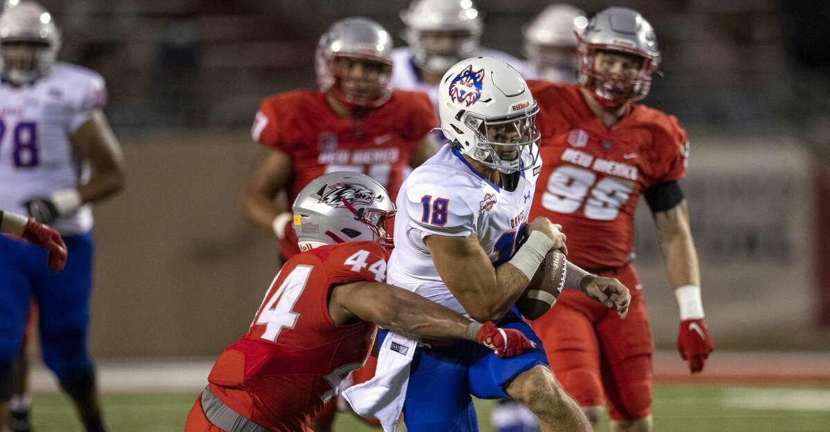 Houston Baptist quarterback Blaise Bentsen (18) is brought down by New Mexico linebacker Reco Hannah (44) during the second half of an NCAA college football game Thursday, Sept. 2, 2021, in Albuquerque, N.M. (AP Photo/Andres Leighton)