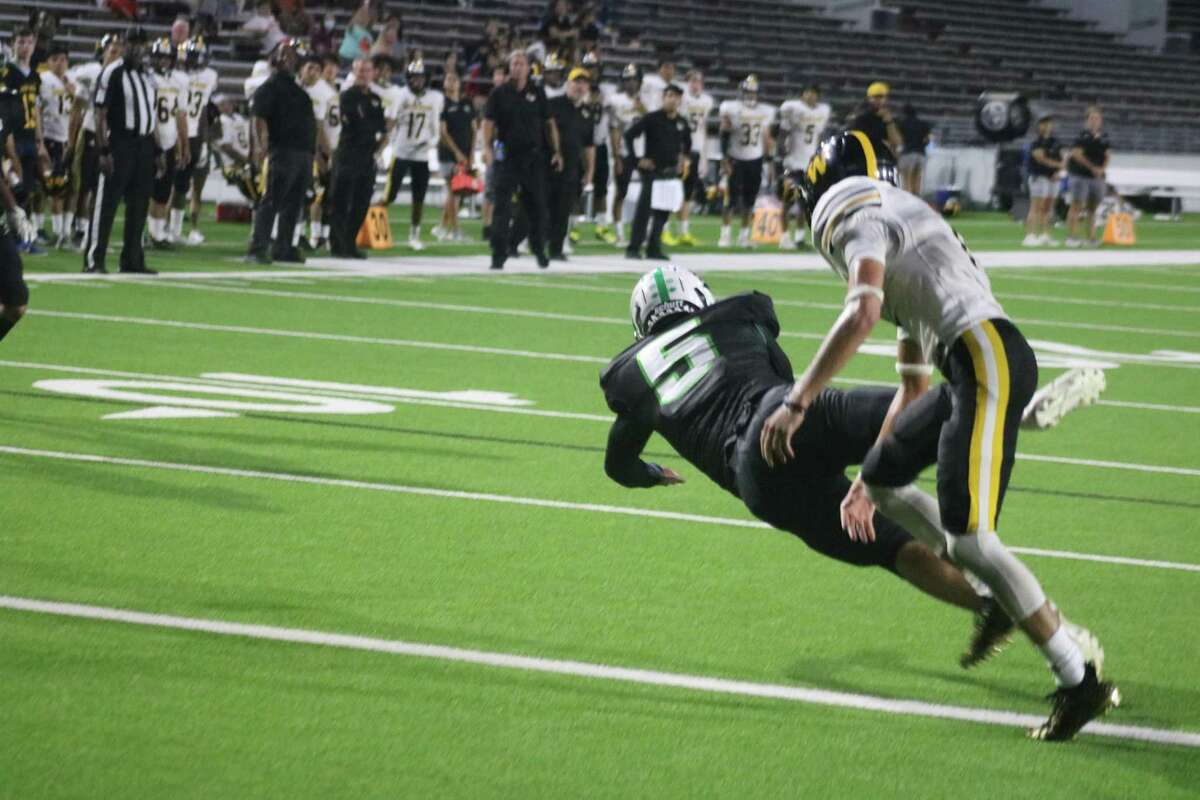 Pasadena's Adan Trigo lunges for an attempt at a first half-ending touchdown reception after his quarterback was forced to scramble for his life.