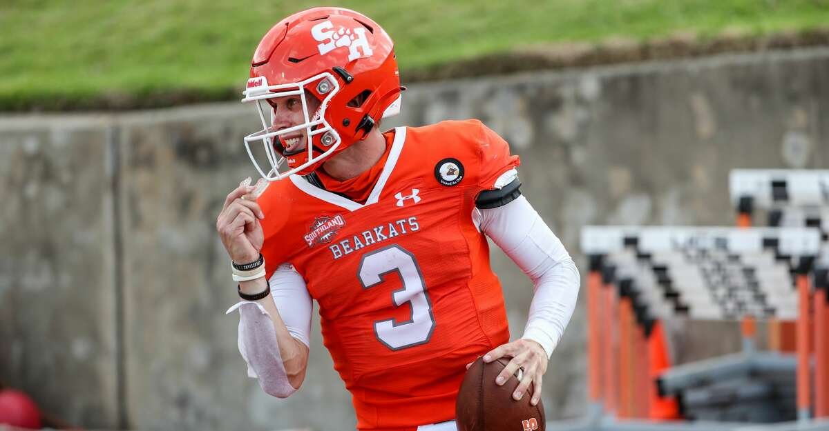 Sam Houston State quarterback Eric Schmid reacts after scoring a touchdown on an 11-yard run against James Madison during the fourth quarter of a semifinal game in the NCAA FCS football playoffs on Saturday, May 8, 2021, in Huntsville. Sam Houston came from behind to edge James Madison 38-35, for a berth in the FCS national championship game.