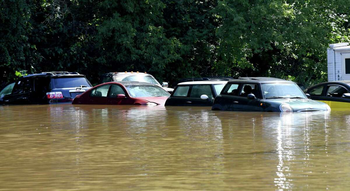 Cars parked in a lot at EZ2Drive Auto Group on Federal Road in Danbury are partially submerged on Sept. 2 after heavy rains from Hurricane Ida drenched the area the day before and into the night.