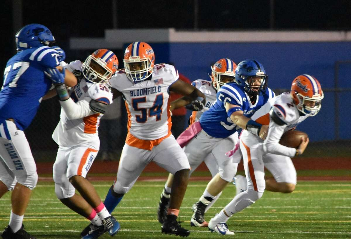 Plainville's Alexander Santini sacks Bloomfield quarterback Daron Bryden at Plainville high school on Oct. 4, 2019.