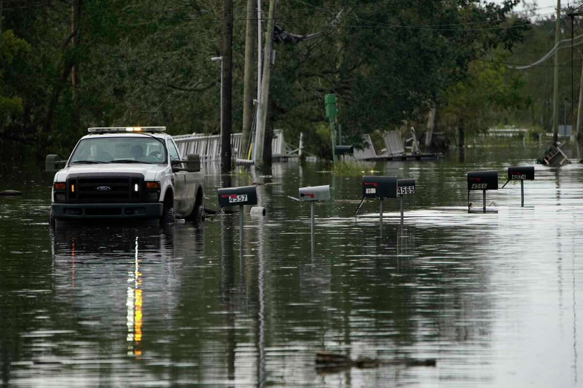 Mailboxes line a flooded street in the aftermath of Hurricane Ida, Wednesday, Sept. 1, 2021, in Lafitte, La. Following Hurricane Ida, mutual aid networks sprang into action to supplement the more established relief services from federal and local governments, and charities. (AP Photo/John Locher)