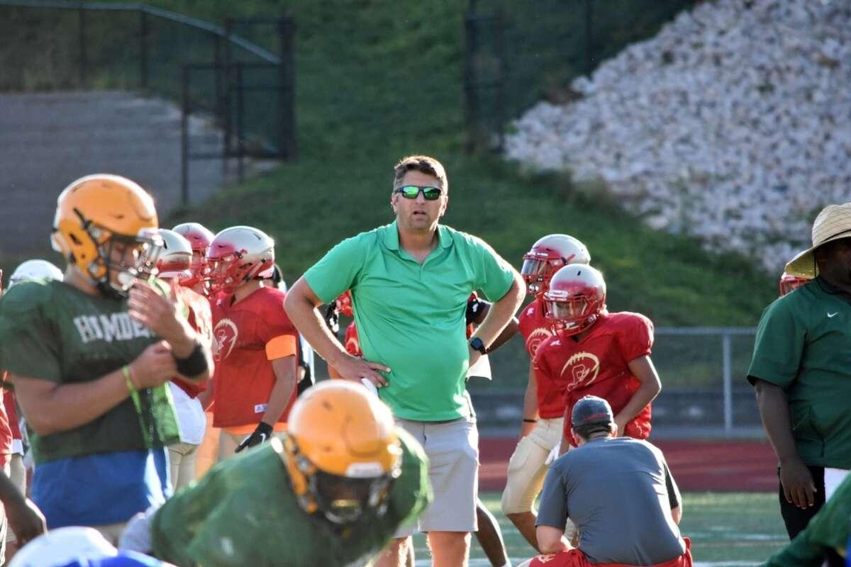 Hamden coach Tom Dyer watches his team at Hamden high school on Thursday, August 29, 2019.