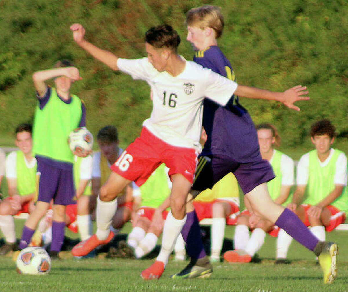 CM's Lucas Ambrose, right, scored his team's only goal Thursday in a 1-0 non-conference win at Jacksonville. It was the fifth goal of the season for Ambrose and helped the Eagles stay undefeated at 5-0. He is shown in action last season against Triad.