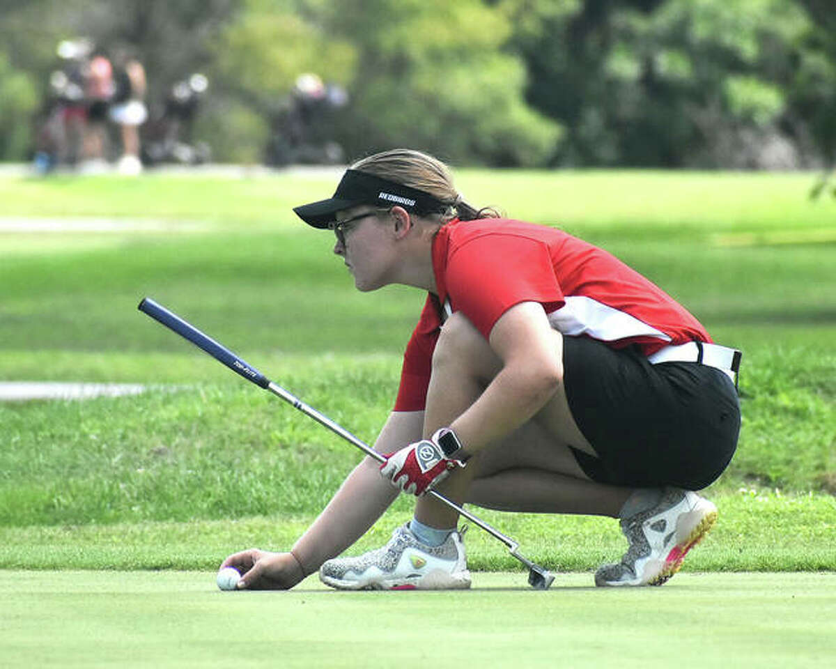 Alton freshman Addison Kenney lines up a putt at Legacy Golf Course during the Madison County Tournament on Aug. 16 in Granite City. On Thursday, Kenney shot a personal best 38 in a SWC triangular at Rolling Hills in Godfrey.