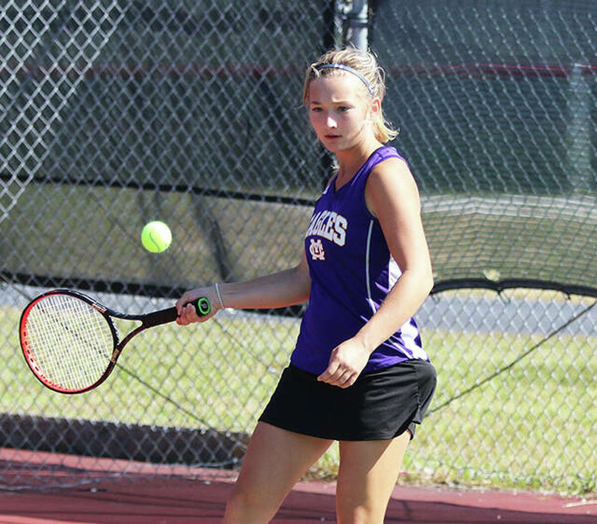 CM's Allie Lively returns a shot during a match last season at the Logan Tournament in Alton. Lively picked up singles and double victories Thursday in the Eagles' 9-0 win over Collinsville.