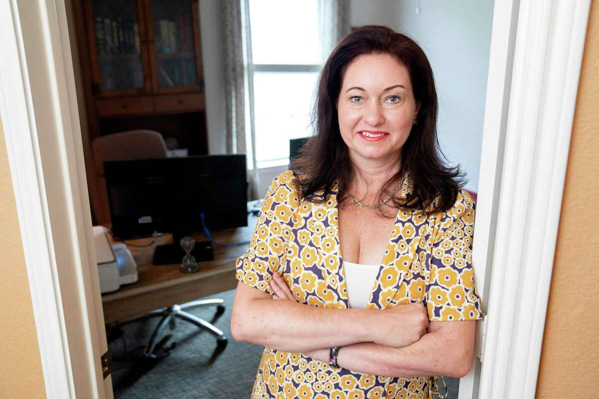 Tamara Greenfield poses for a portrait in the bedroom turned home office where she works as a recruiting manager for a home healthcare company Thursday, September 2, 2021 at her home in Plano, Texas. After having her position eliminated three times by the staffing agency she worked for during the COVID-19 pandemic, Greenfield recently received three new job offers as the economy has continued to recover.
