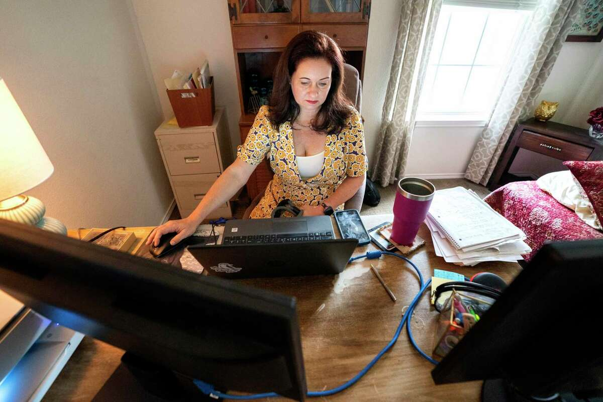 Tamara Greenfield works in her bedroom turned home office as a recruiting manager for a home healthcare company Thursday, September 2, 2021 at her home in Plano, Texas. After having her position eliminated three times by the staffing agency she worked for during the COVID-19 pandemic, Greenfield recently received three new job offers as the economy has continued to recover.