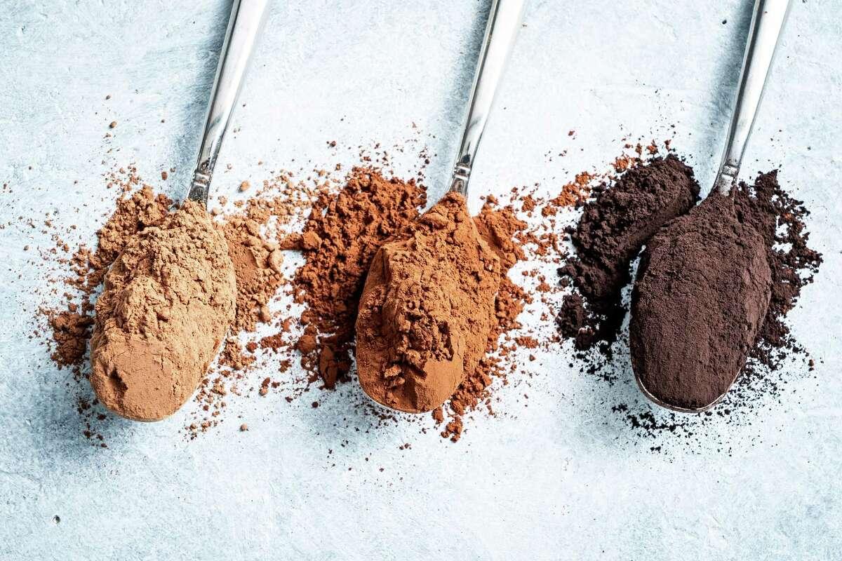 Natural Cocoa Powder, Dutch-Processed Cocoa Powder, and Black Cocoa Powder photographed in Arlington, Va., on Aug. 24, 2021.