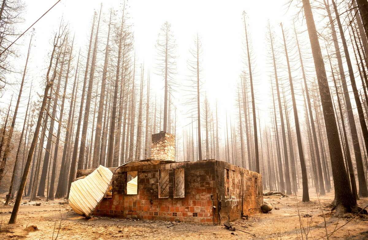 The remains of a house burned during the Caldor fire in Twin Bridges, California, on September 1, 2021. At least 650 structures were burned and thousands more are threatened during the Caldor fire moving to the resort community in South Lake Tahoe, California.  .