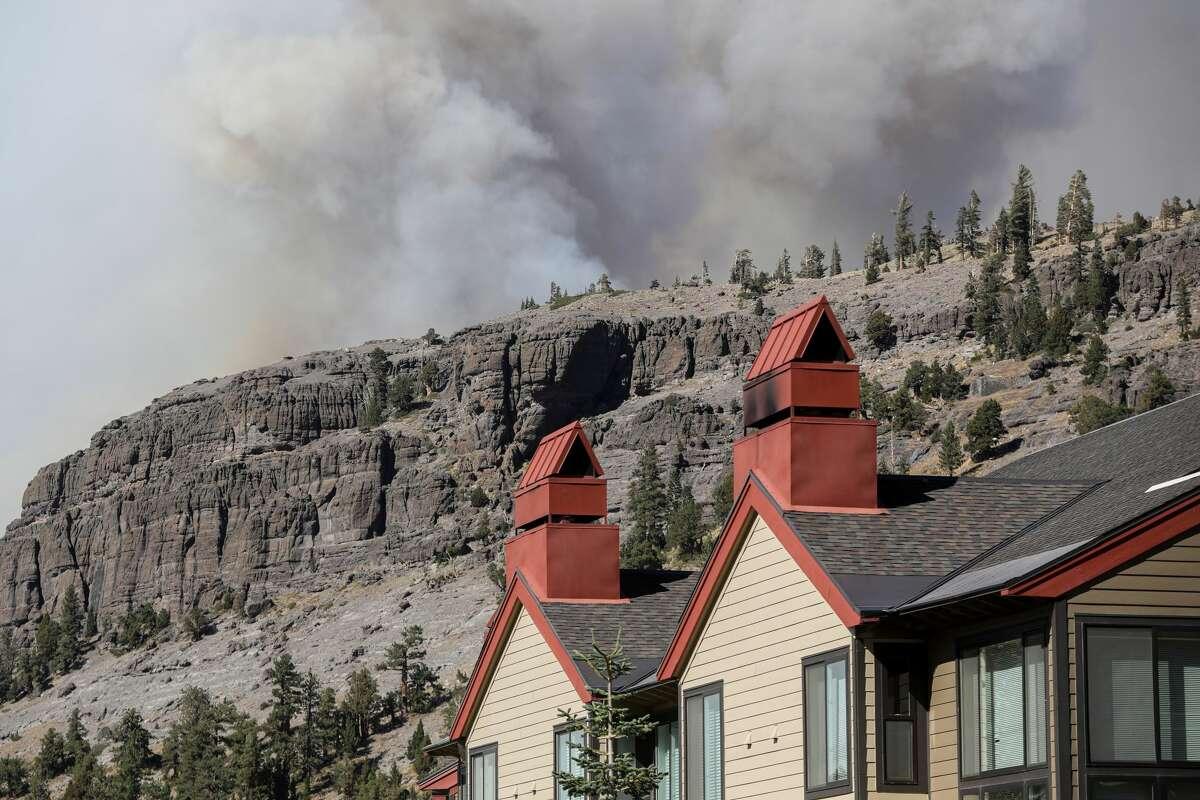 Smoke from the Caldor Fire rose on a ridge near the Kirkwood Mountain Resort in Kirkwood, California, on Wednesday, September 1, 2021.