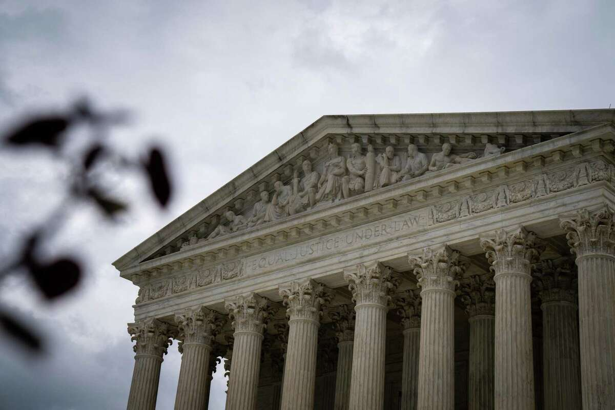 """The Supreme Court building in Washington, hours before the justices left in place a Texas law barring most abortions in the state via an unsigned ?""""shadow docket?• ruling, on Wednesday, Sept. 1, 2021. With increasing frequency, the court is taking up weighty matters in a rushed way, considering emergency petitions that often yield late-night decisions issued with minimal or no written opinions. (Sarahbeth Maney/The New York Times)"""
