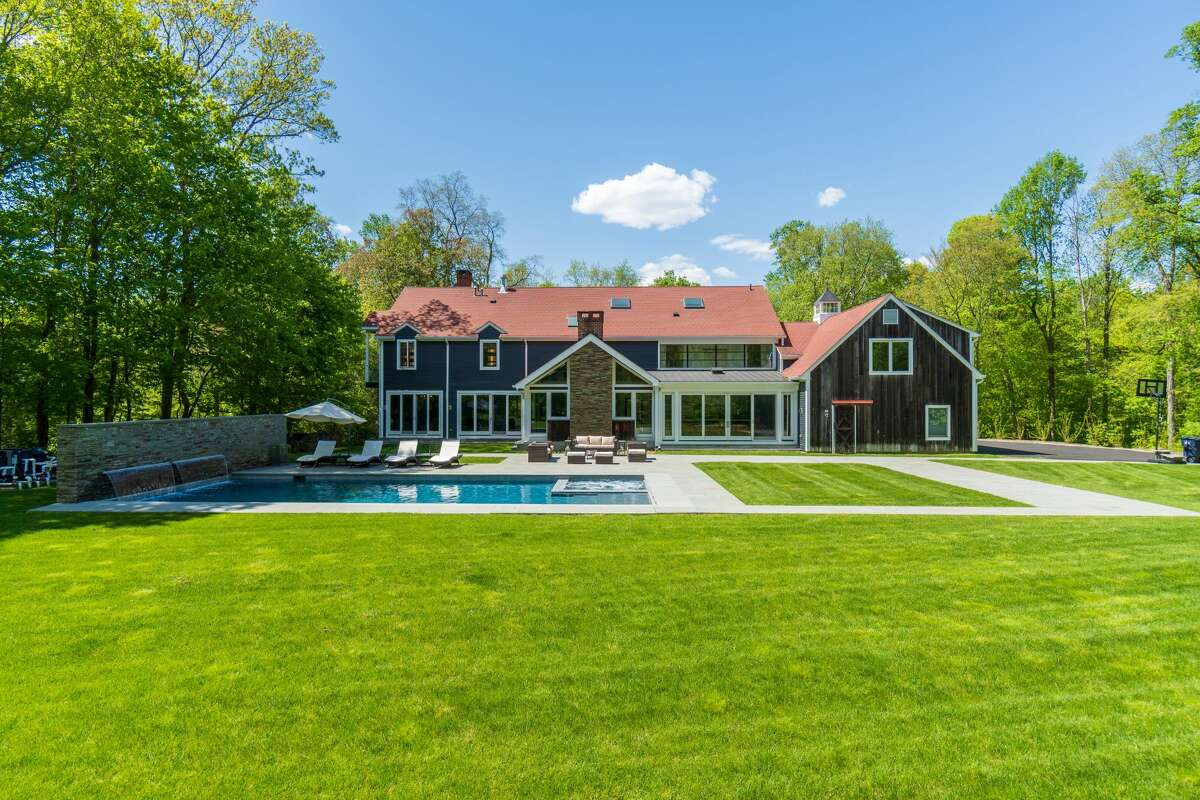 The home on 71 Richmond Hill Road in Greenwich, Conn. has 4 acres of land, a pool and spa with a waterfall.