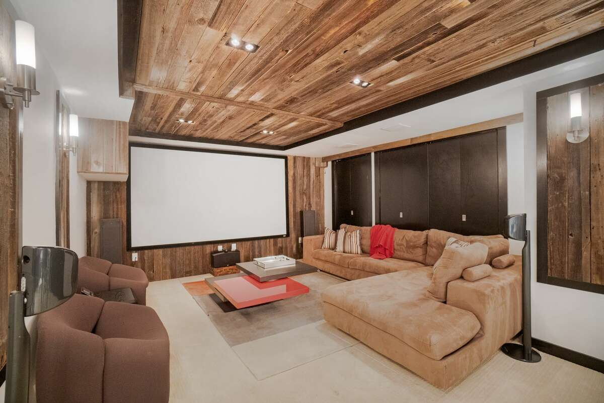 The home on 71 Richmond Hill Road in Greenwich, Conn. has a media room in its lower level.