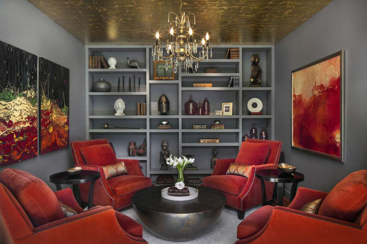 The sitting room in the home on 71 Richmond Hill Road in Greenwich, Conn. has an embellished ceiling.