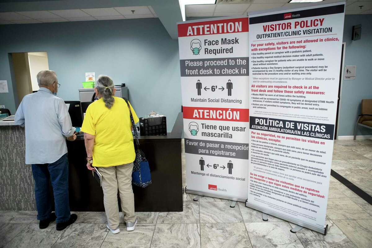 People check in at the front desk in the Post-Covid Clinic on the UTMB Clear Lake campus Tuesday, Aug. 31, 2021 in Houston. The clinic is working with patients dealing with stubborn Covid-19 symptoms and getting analyzed for treatment.