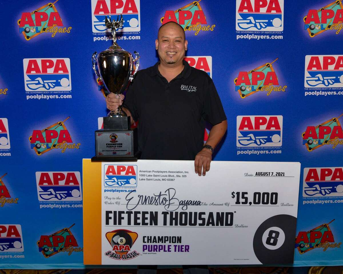 Tomball resident Ernesto Bayaua holds a check for $15,000 after winning the 2020-2021 APA 8-Ball Classic Pool Championship in early August 2021 in Las Vegas.