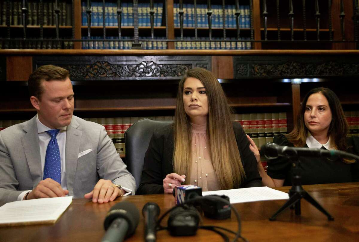 Felecia McKinney, a Harris County Precinct 1 deputy constable, speaks about the order given to her by Constable Alan Rosen to be sexually assaulted in August 2019 for a case Friday, Sept. 3, 2021, in Houston. McKinney claimed she had to drove herself to a hospital while Rosen held a victory news conference. McKinney is joined by her lawyer Cordt Akers, left, and Jacquelyn Aluotto, who worked for the agency as an advocate for victims of human trafficking.