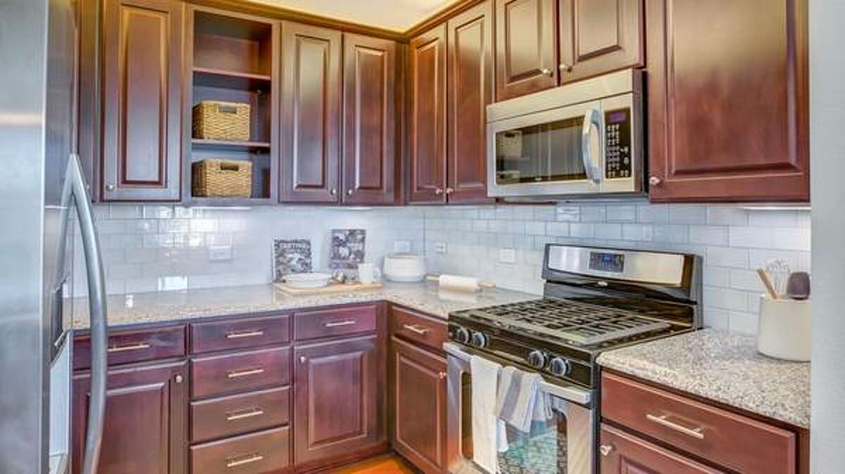 The kitchen offers a Tuscan-inspired design.