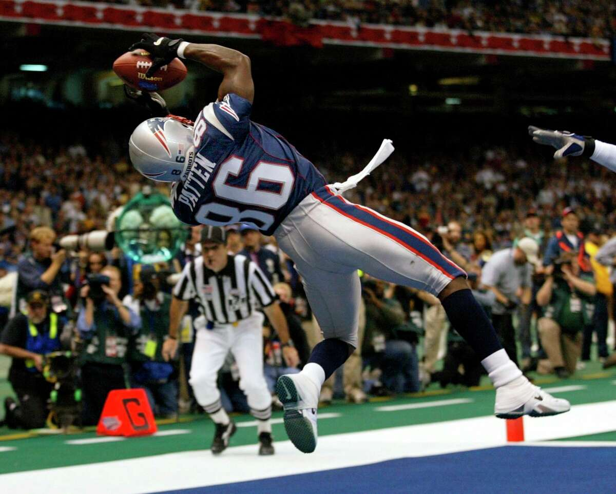 In this Feb. 3, 2002, file photo, New England Patriots wide receiver David Patten grabs a touchdown pass during the second quarter of Super Bowl XXXVI against the St. Louis Rams at the Louisiana Superdome in New Orleans, La. Patten, who caught Tom Brady's first postseason touchdown to help the Patriots win their first Super Bowl, was killed in a motorcycle accident on Thursday night, Sept. 2, 2021, outside of Columbia, S.C., Richard County coroner Naida Rutherford said in a statement. He was 47. Patten played 12 seasons in the NFL after signing as an undrafted free agent with the New York Giants in 1997.